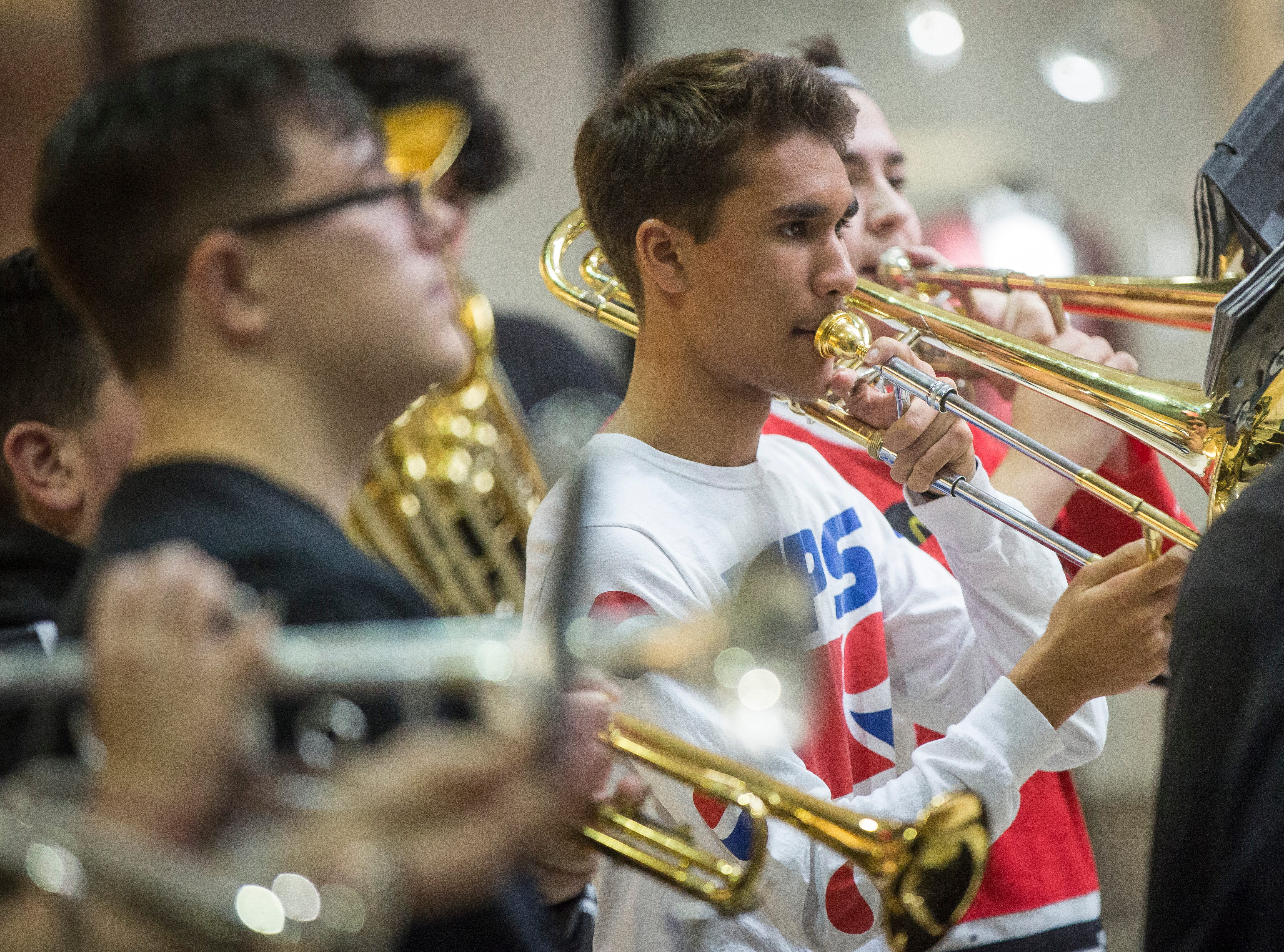 Central's pep band helps rally the crowd of people Saturday who were gathered for the Salvation Army's Red Kettle Campaign Kickoff at the Muncie Mall. So far the organization has raised seven percent of their $207,000 goal.