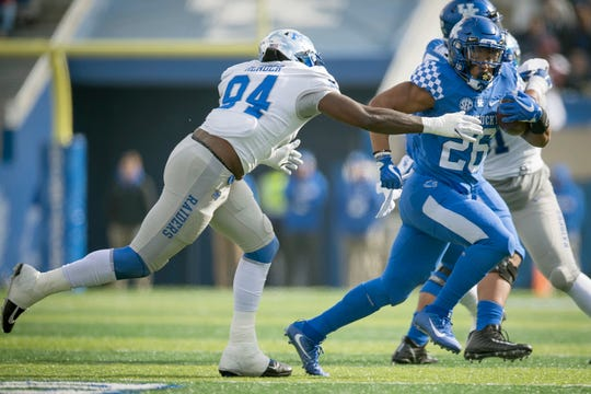 Kentucky running back Benny Snell Jr. (26) runs with the ball during the first half of an NCAA college football game against Middle Tennessee in Lexington, Ky., Saturday, Nov. 17, 2018.