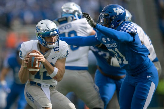 Kentucky linebacker Jamar Watson (31) pressures Middle Tennessee quarterback Brent Stockstill (12) during the first half of an NCAA college football game in Lexington, Ky., Saturday, Nov. 17, 2018.