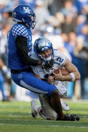 Kentucky cornerback Chris Westry (21) sacks Middle Tennessee quarterback Brent Stockstill (12) during the second half of an NCAA college football game against Kentucky in Lexington, Ky., Saturday, Nov. 17, 2018.