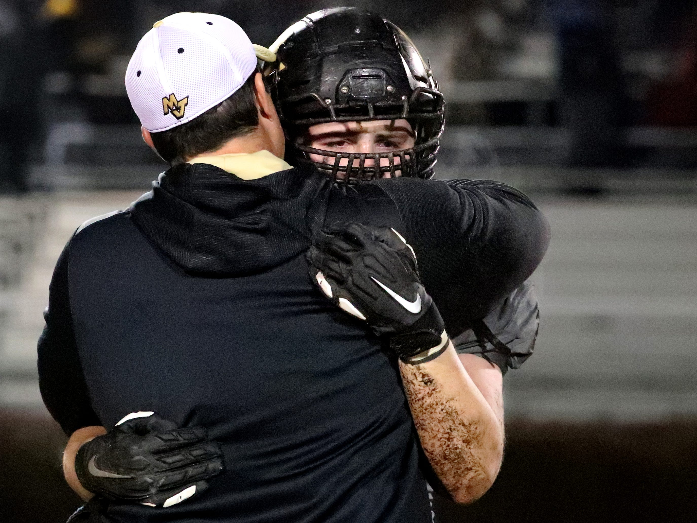 Mt. Juliet's senior Ronnie Kramer (62) is comforted after losing to Oakland 14-7 at Mt Juliet, on Friday, Nov. 16,  2018, during the Class 6A quarterfinal.