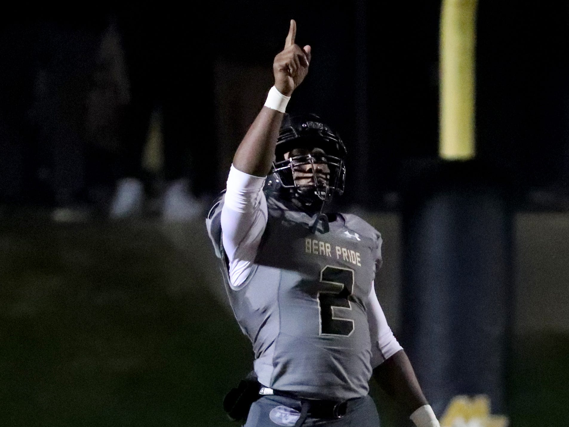 Mt. Juliet's Marcello Walton (2) points to the sky before the ball is kicked to start the game against Oakland, on Friday, Nov. 16,  2018, during the Class 6A quarterfinal.