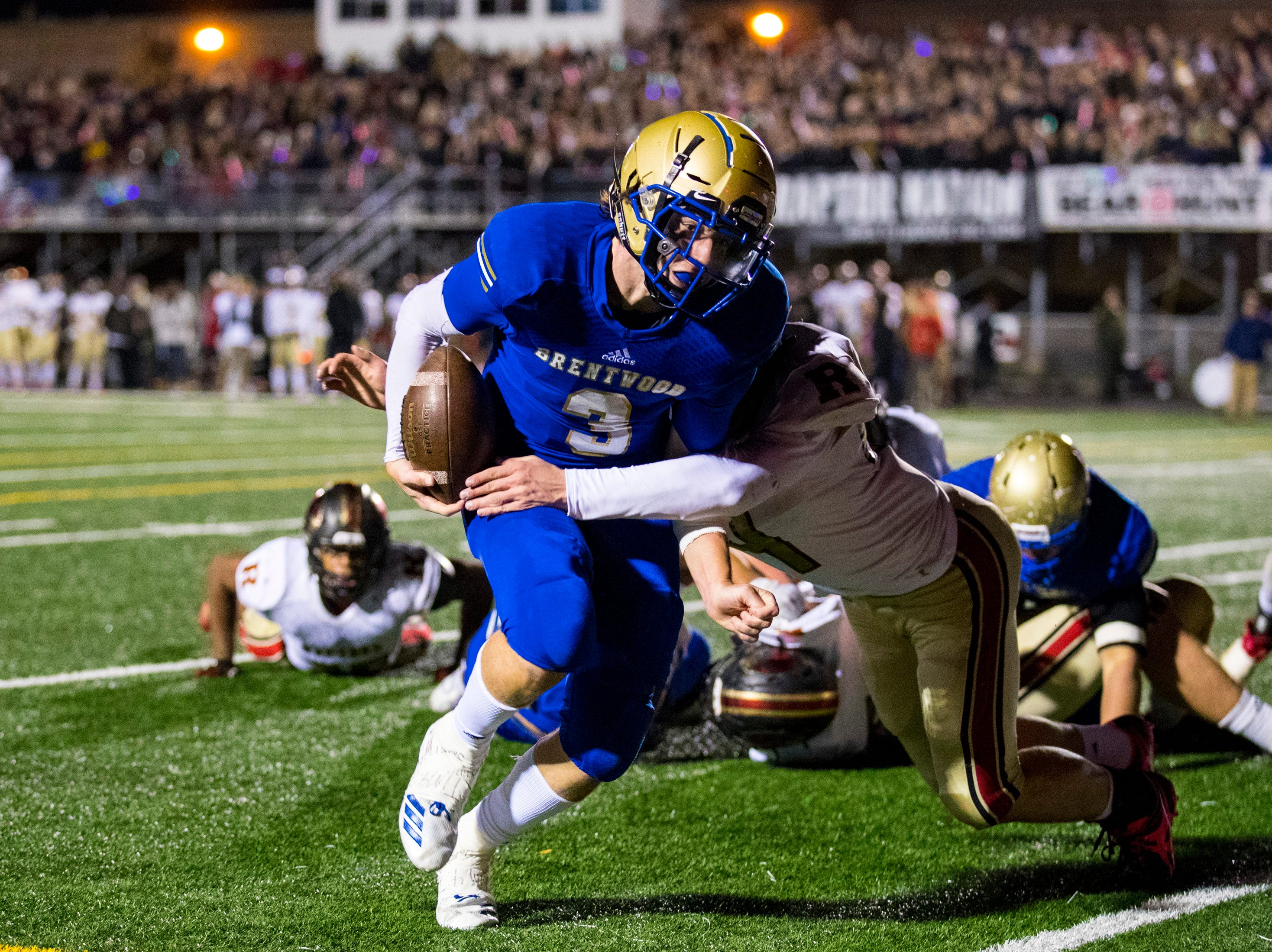 Brentwood's Cade Granzow (3) makes it into the endzone during Brentwood's game against Ravenwood at Brentwood High School in Brentwood on Friday, Nov. 16, 2018.