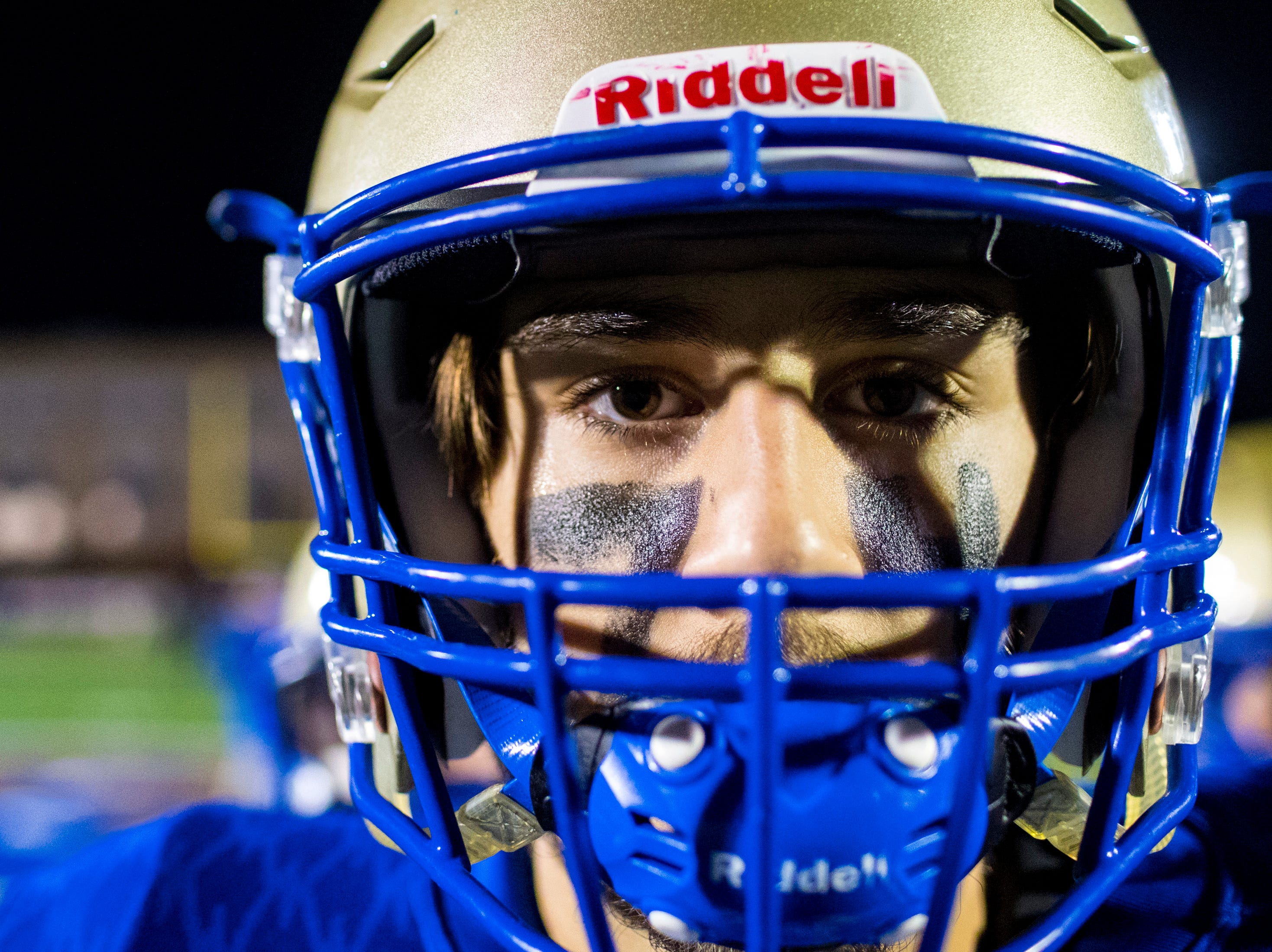Brentwood's Ben Brannon (84) has the number 74 on his face in face paint before Brentwood's game against Ravenwood at Brentwood High School in Brentwood on Friday, Nov. 16, 2018.