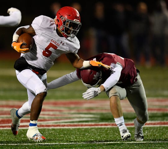 Brentwood Academy running back Tomario Pleasant (5) powers past an MBA defender during the second quarter of their 2018 Division II Class AAA State Football Playoff game at Montgomery Bell Academy Friday, Nov. 16, 2018, in Nashville, Tenn.
