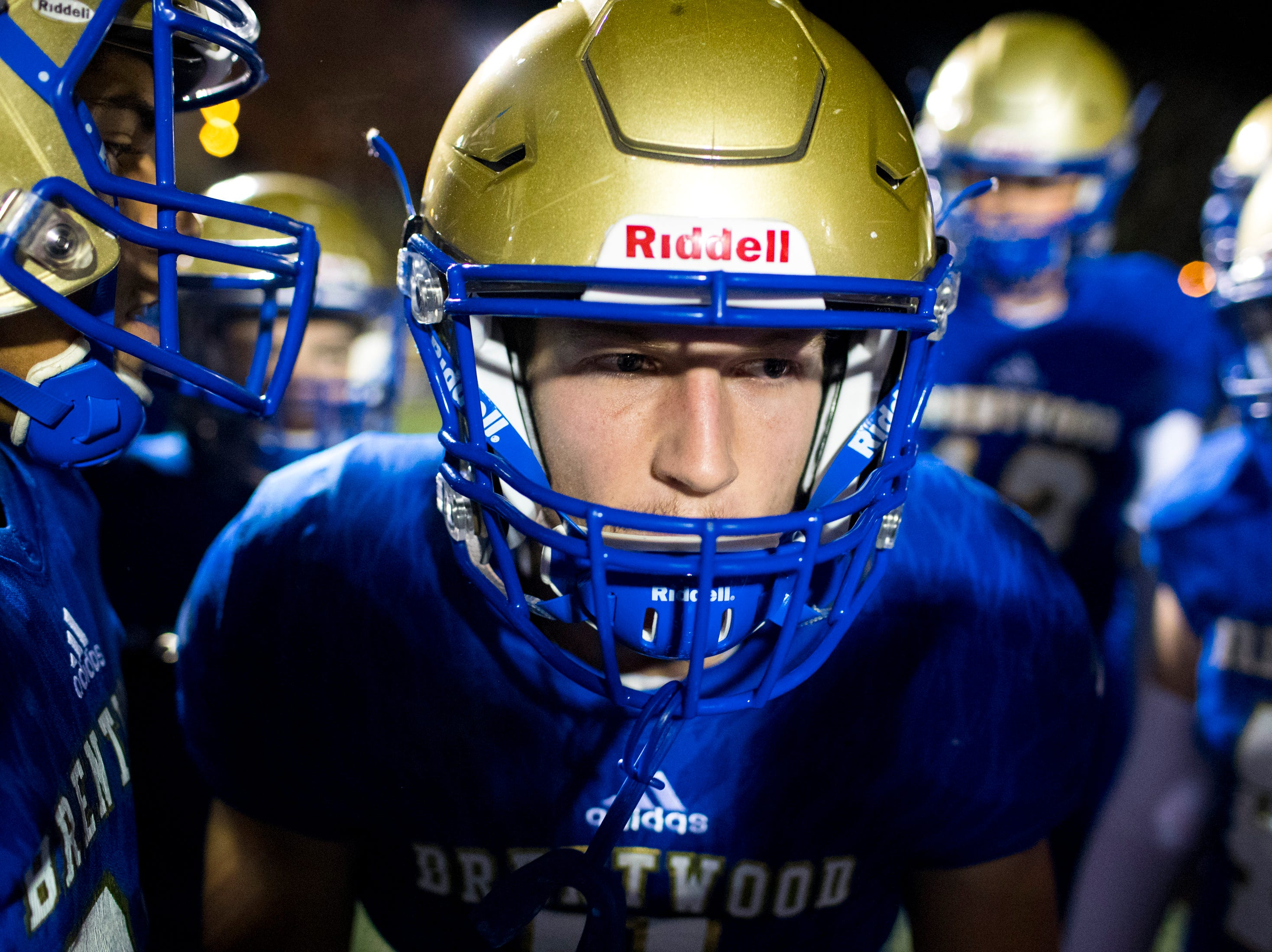 Brentwood's Michael Burke (8) gets his teammates hyped up before Brentwood's game against Ravenwood at Brentwood High School in Brentwood on Friday, Nov. 16, 2018.