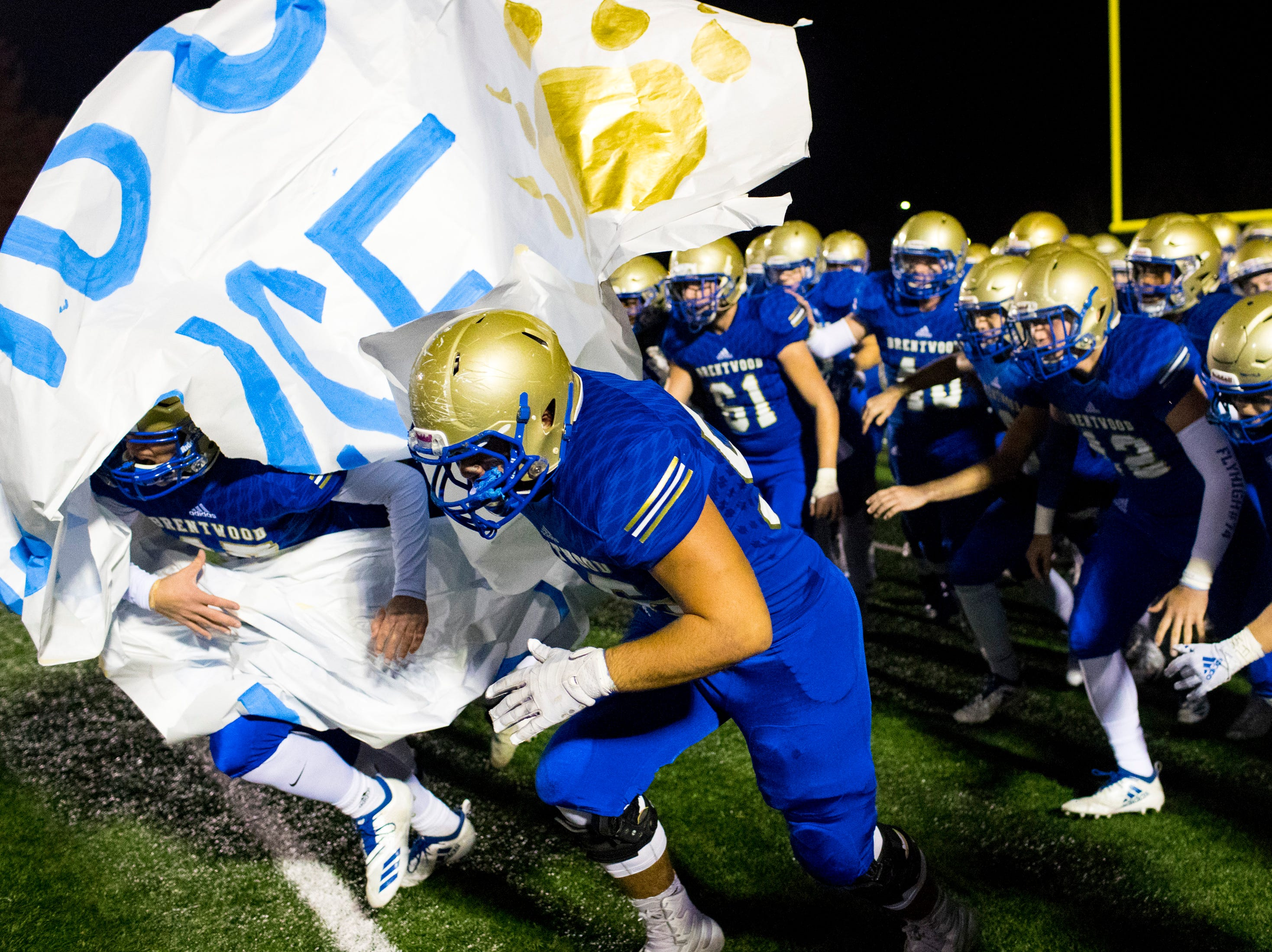 Brentwood's players take the field before Brentwood's game against Ravenwood at Brentwood High School in Brentwood on Friday, Nov. 16, 2018.