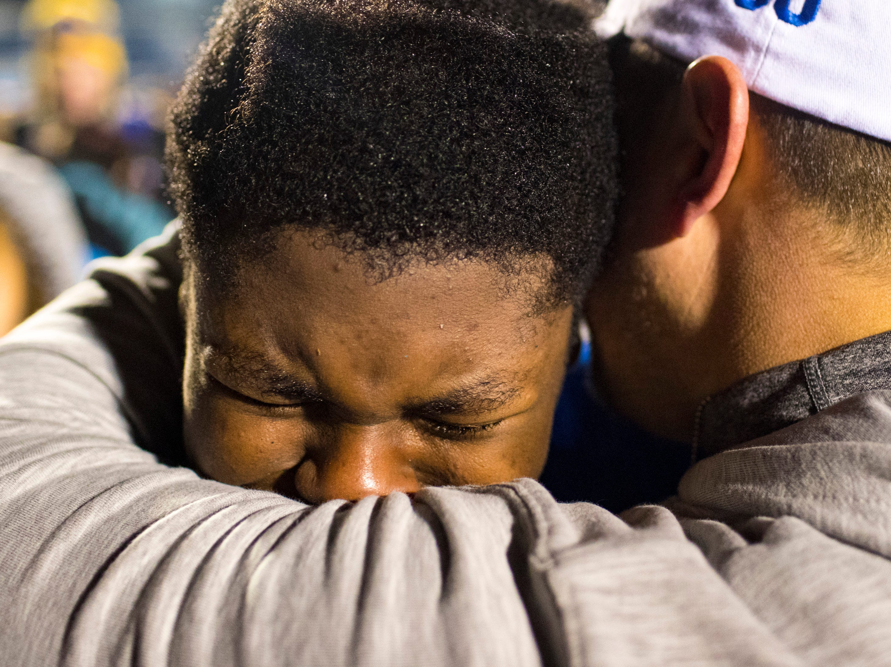 Brentwood's James Lowe II (63) is comforted after Brentwood's game against Ravenwood at Brentwood High School in Brentwood on Friday, Nov. 16, 2018.