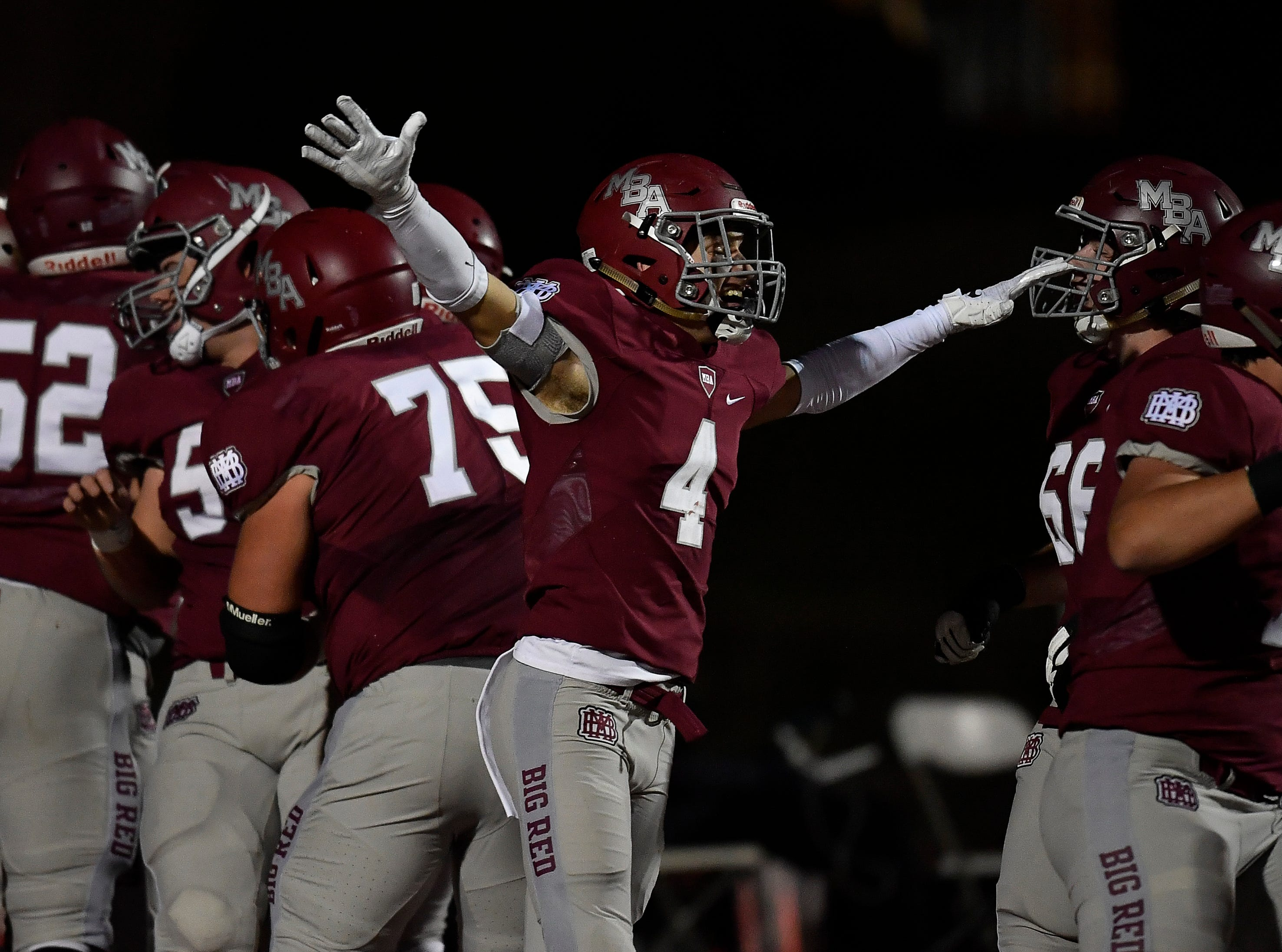 MBA celebrates their touchdown during the second quarter against Brentwood Academy during their 2018 Division II Class AAA State Football Playoff game at Montgomery Bell Academy Friday, Nov. 16, 2018, in Nashville, Tenn.