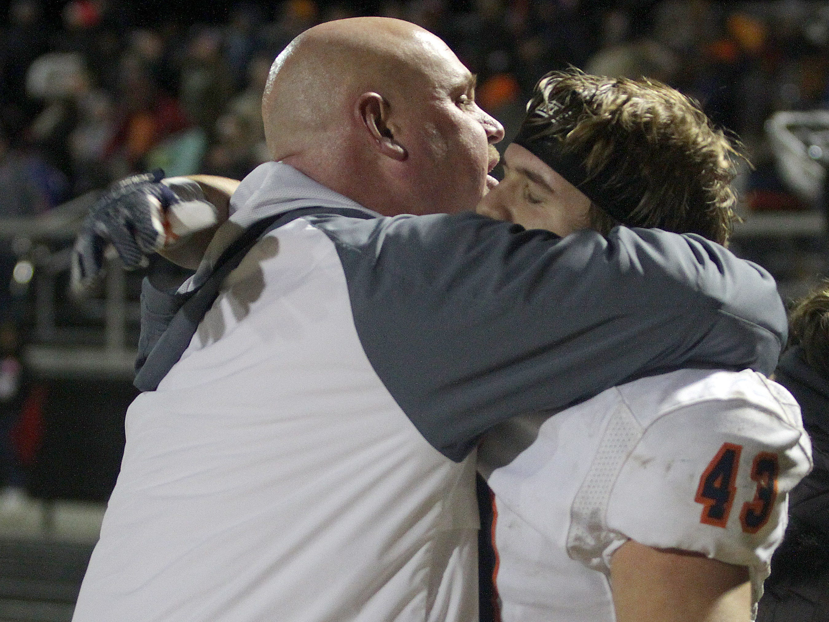 Beech Coach Anthony Crabtree gives Will Crabtree a hug after their win over Hillsboro on Friday, November 16, 2018.