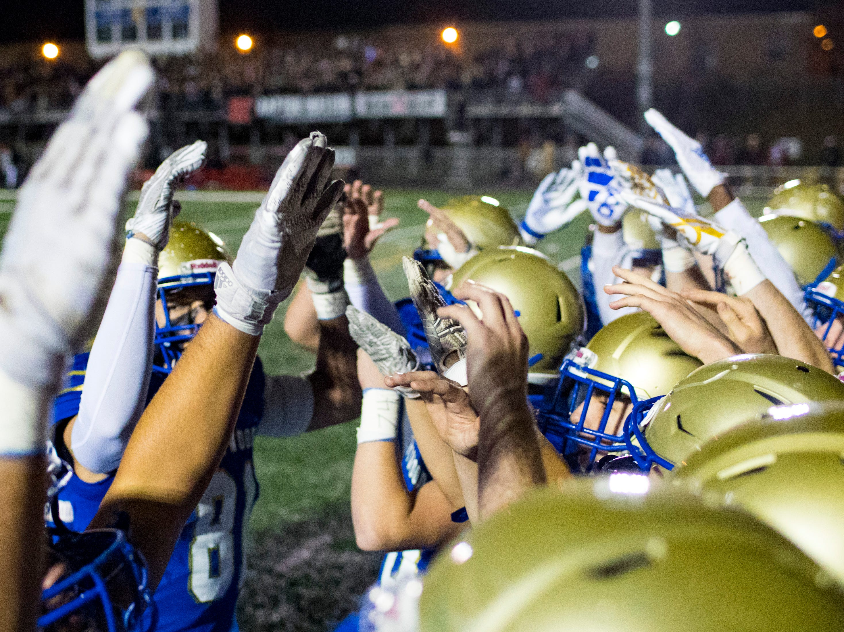 Brentwood's players get hyped up before taking the field for Brentwood's game against Ravenwood at Brentwood High School in Brentwood on Friday, Nov. 16, 2018.