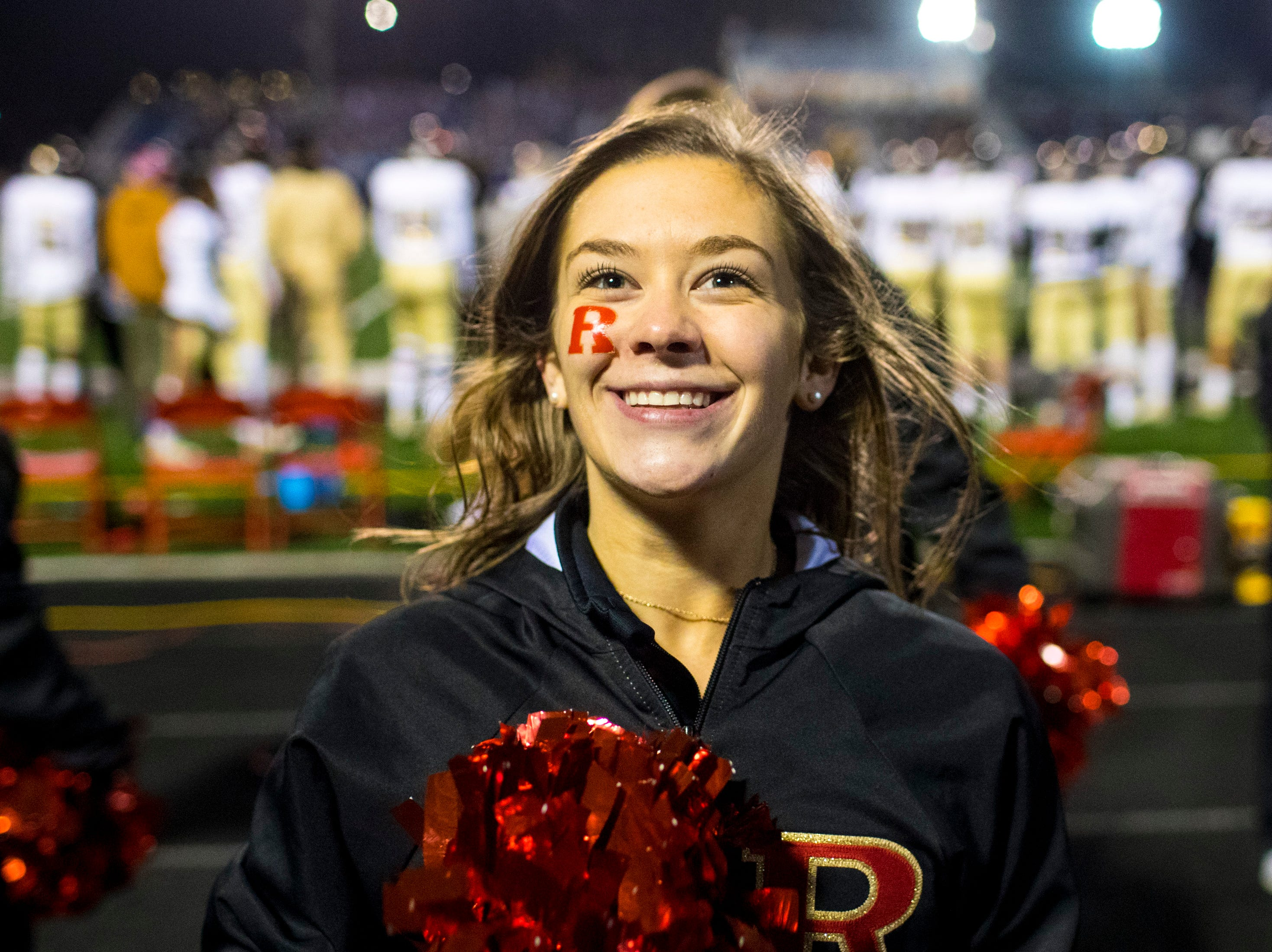 Ravenwood cheerleader Addie Raymer cheers during Brentwood's game against Ravenwood at Brentwood High School in Brentwood on Friday, Nov. 16, 2018.