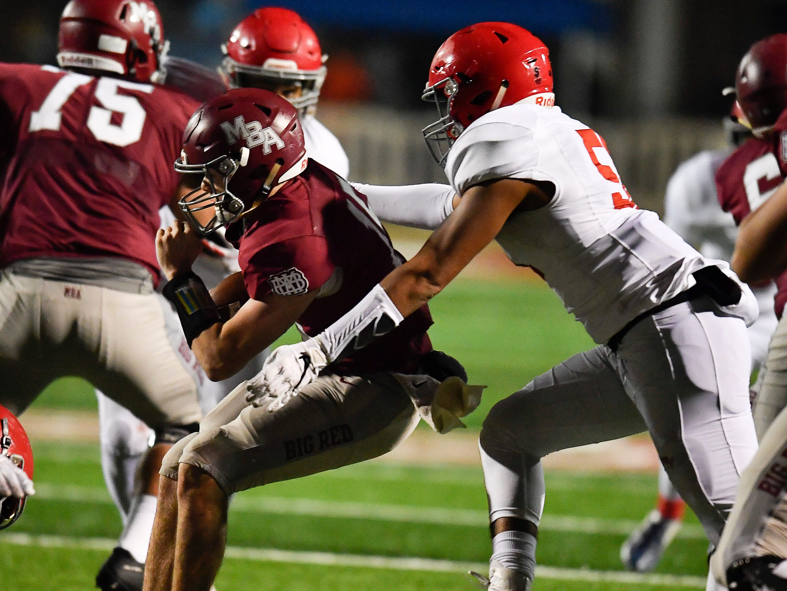 MBA quarterback William Tyrone (15) is sacked by Brentwood Academy defensive lineman Yirayah Lanier (51) during the fourth quarter of their 2018 Division II Class AAA State Football Playoff game at Montgomery Bell Academy Friday, Nov. 16, 2018, in Nashville, Tenn.