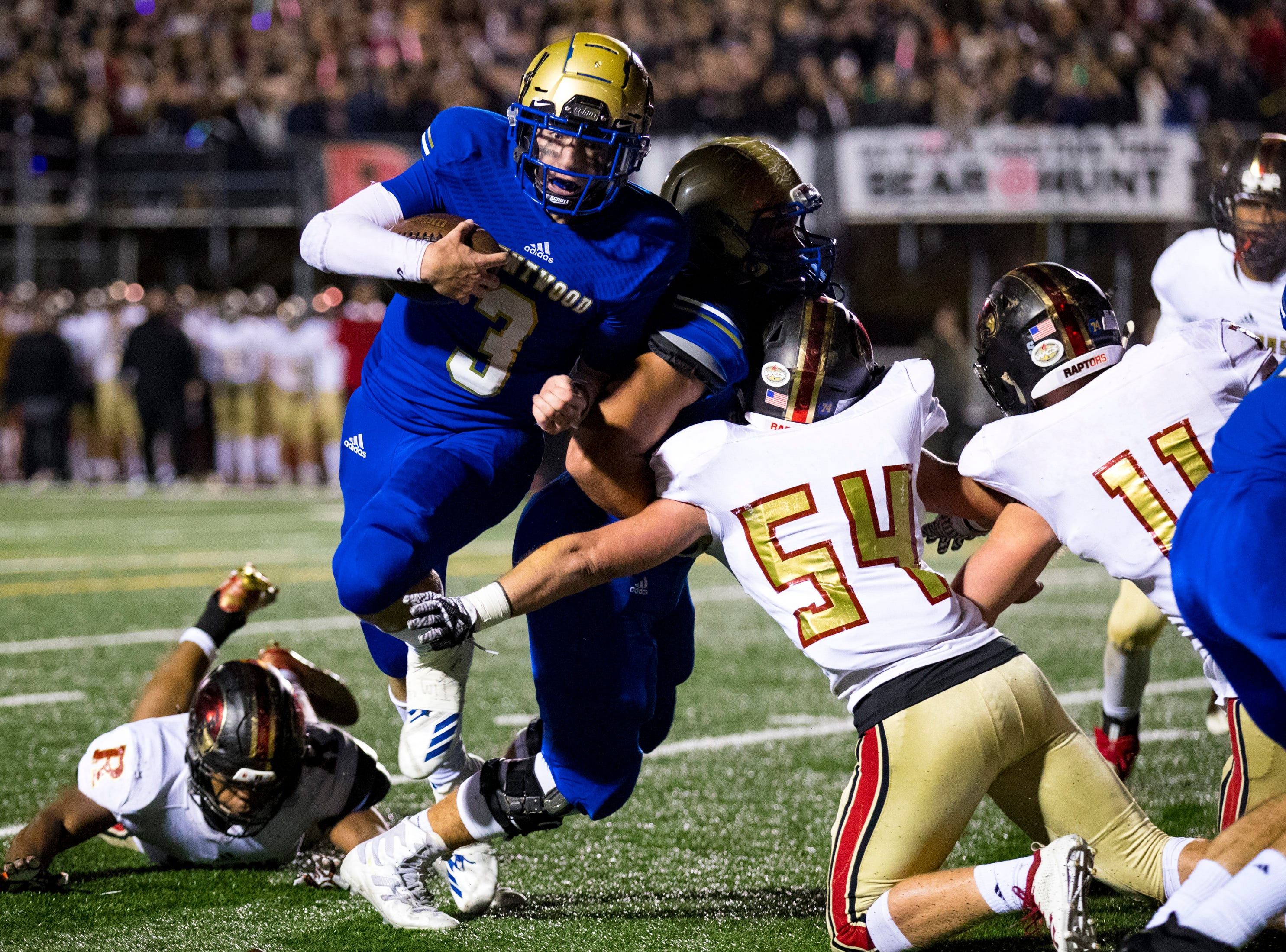 Brentwood's Cade Granzow (3) runs in a touchdown during Brentwood's game against Ravenwood at Brentwood High School in Brentwood on Friday, Nov. 16, 2018.