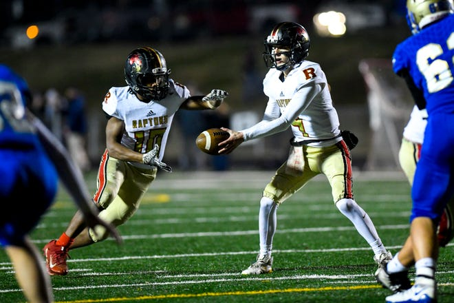 Ravenwood's Brian Garcia (4) hands off to Ravenwood's Antonio Rice (10) during Brentwood's game against Ravenwood at Brentwood High School in Brentwood on Friday, Nov. 16, 2018.