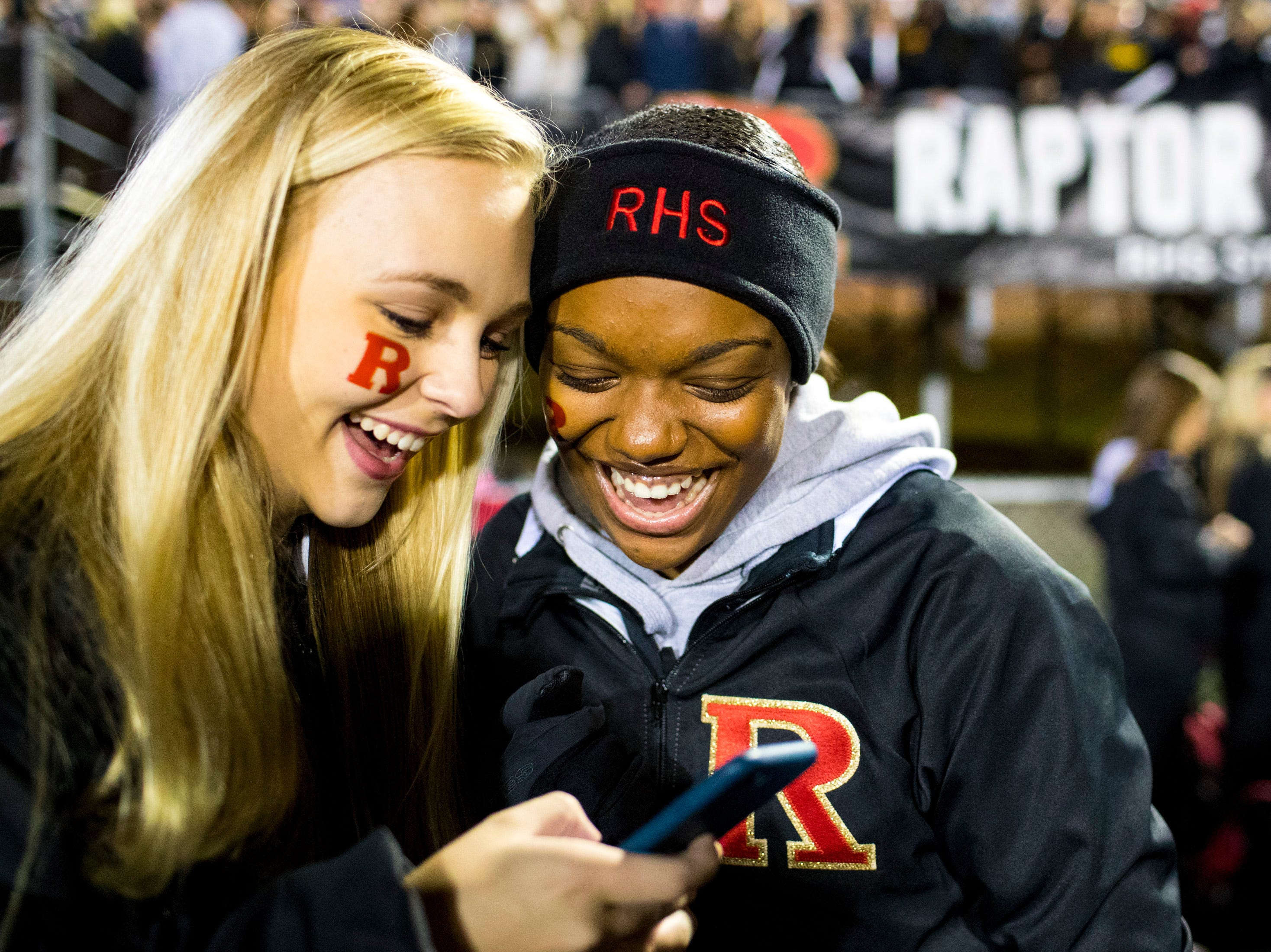 Kaylea Winton, left, and Paige Fisher look over photos they had just taken before Brentwood's game against Ravenwood at Brentwood High School in Brentwood on Friday, Nov. 16, 2018.