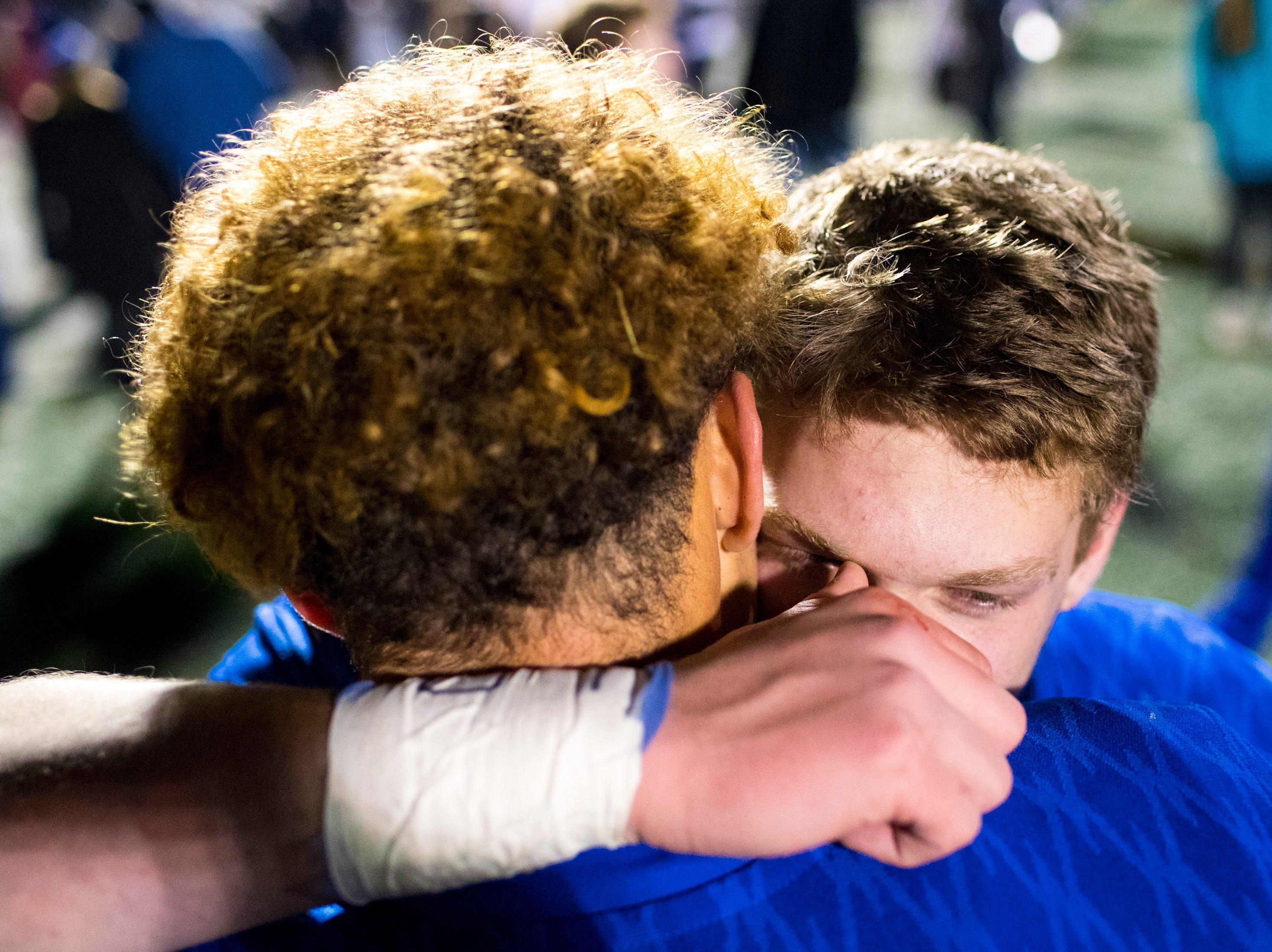 Brentwood's Jordan Nicholas (34), left, and Brentwood's Michael Burke (8) share a hug after Brentwood's game against Ravenwood at Brentwood High School in Brentwood on Friday, Nov. 16, 2018.