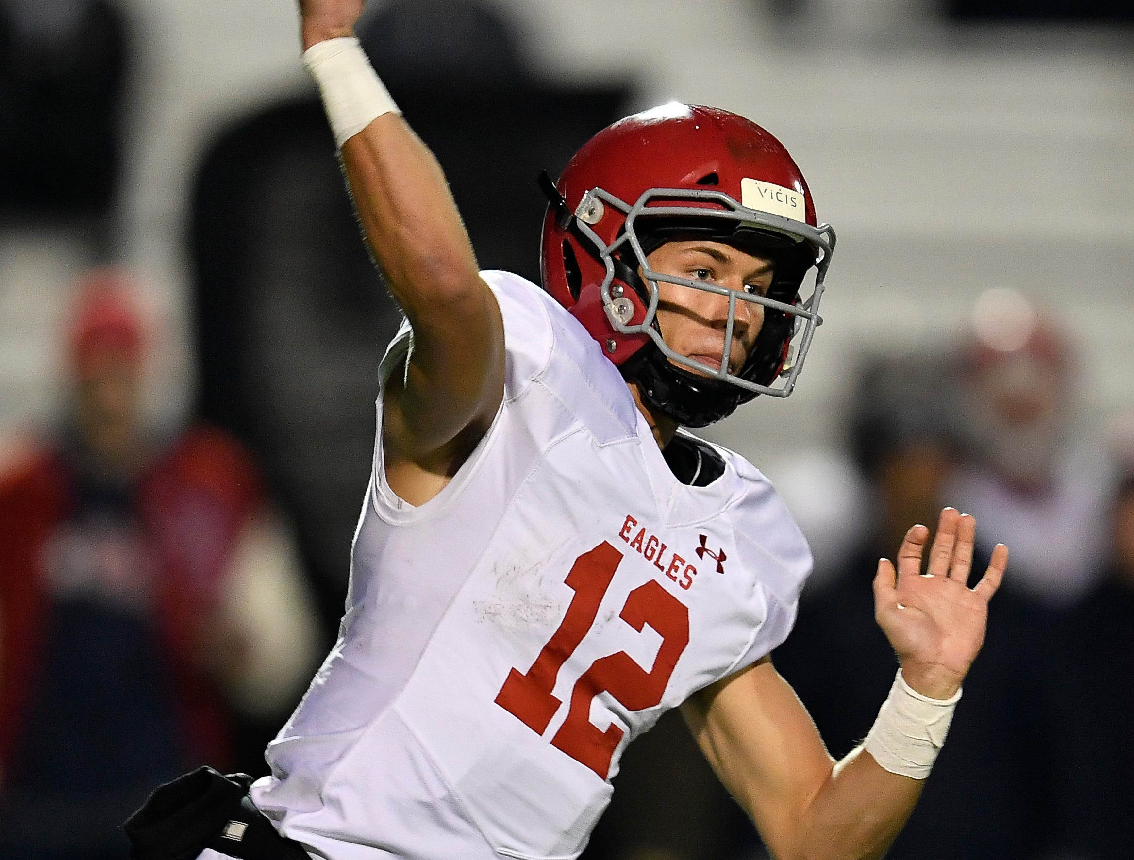 Brentwood Academy quarterback Wade Williams (12) throws a pass against MBA during the first quarter of their 2018 Division II Class AAA State Football Playoff game at Montgomery Bell Academy Friday, Nov. 16, 2018, in Nashville, Tenn.