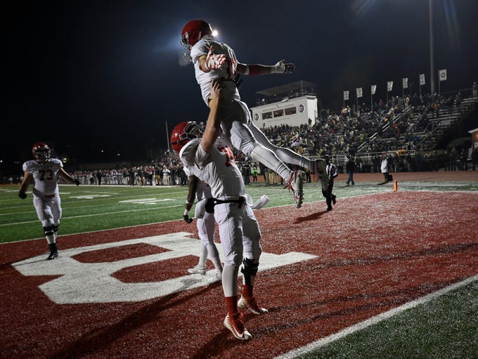 Brentwood Academy defensive back Aaron Lovins (33) celebrates his touchdown with offensive lineman Will Collins (74) during the third quarter of their 2018 Division II Class AAA State Football Playoff game at Montgomery Bell Academy Friday, Nov. 16, 2018, in Nashville, Tenn.