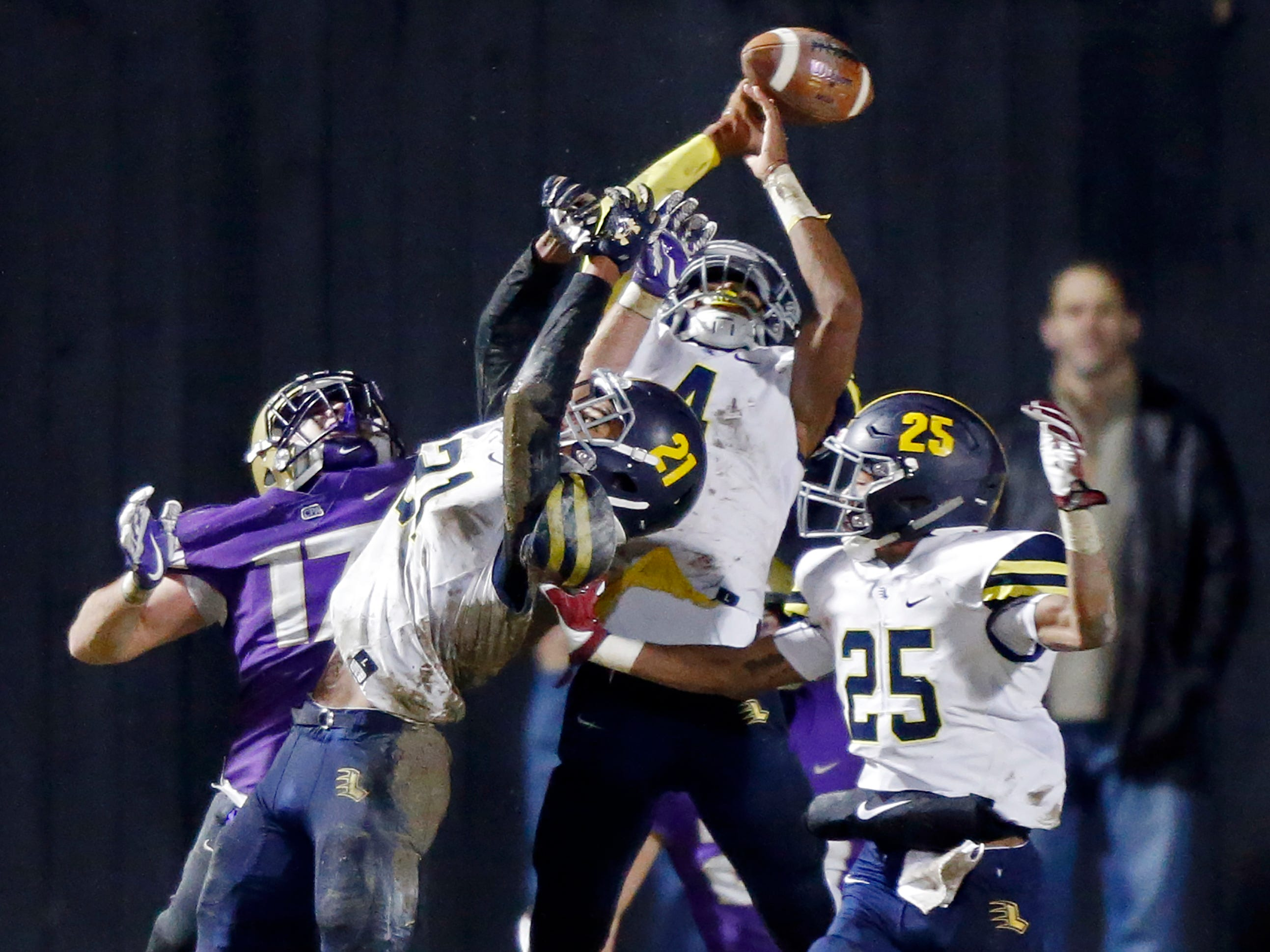 Lausanne's Cameron Simms (4) tries to intercept a Hail Mary pass to end the half during their DII-AA semifinal game against Christ Presbyterian Academy Friday, Nov. 16, 2018, in Nashville, TN.
