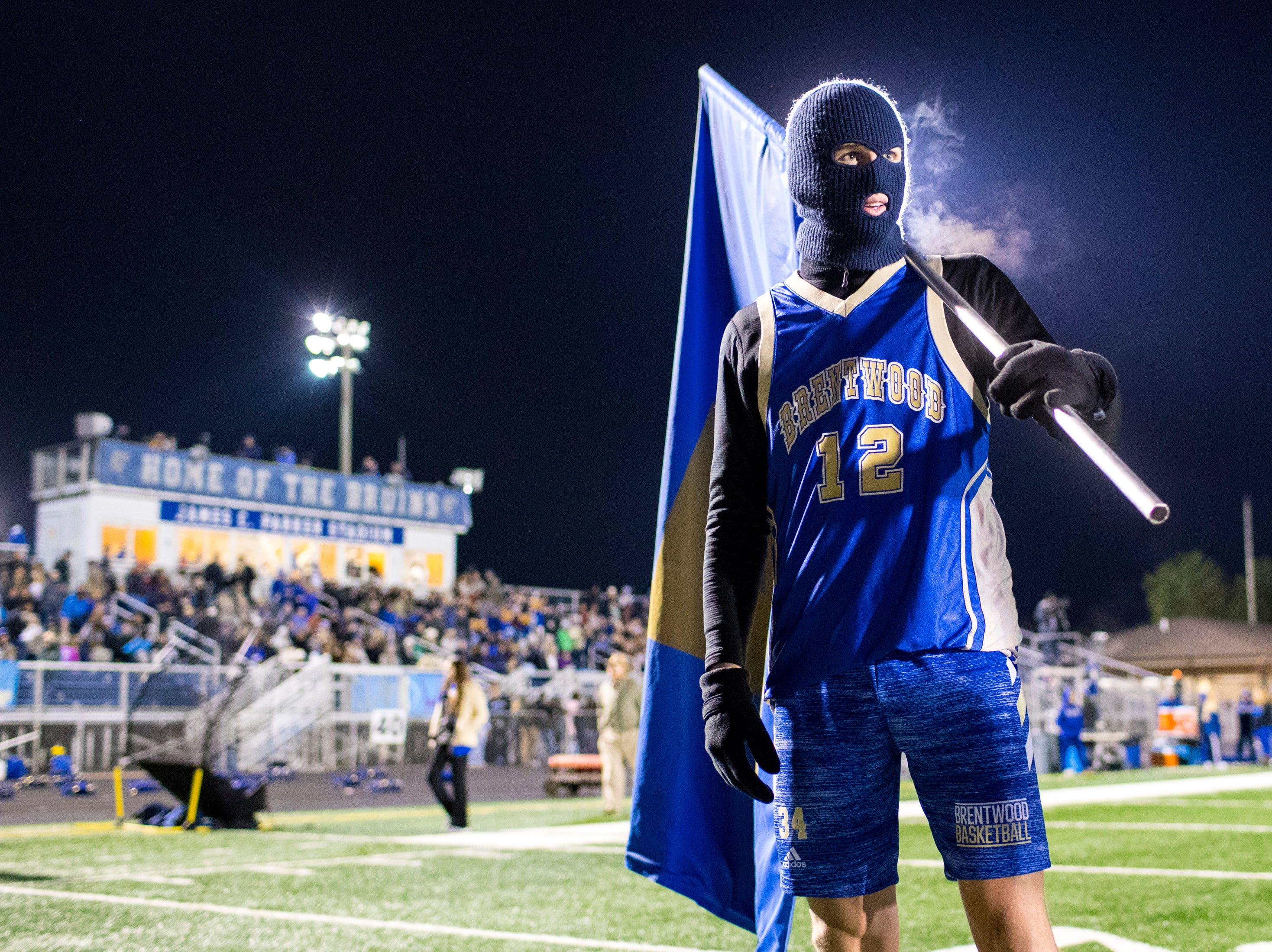 Ben Mills prepares to lead Brentwood's players on to the field before Brentwood's game against Ravenwood at Brentwood High School in Brentwood on Friday, Nov. 16, 2018.