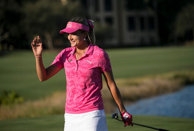 Lexi Thompson of Delray Beach waves to the crowd after her par putt on 18 in the third round of the CME Group Tour Championship on Saturday at Tiburón Golf Club in Naples.