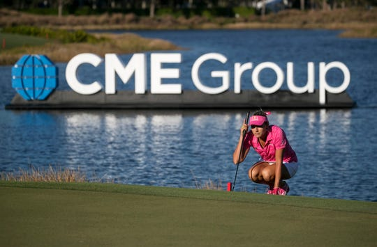 Lexi Thompson of Delray Beach lines up a putt on No. 18 in the third round of the CME Group Tour Championship on Saturday at Tiburón Golf Club in Naples.