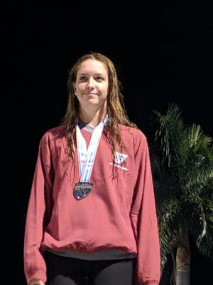 St. John Neumann's Maddy Burt took silver in the 100-yard butterfly in the Class 1A state swimming meet on Friday, Nov. 16, 2018 in Stuart.