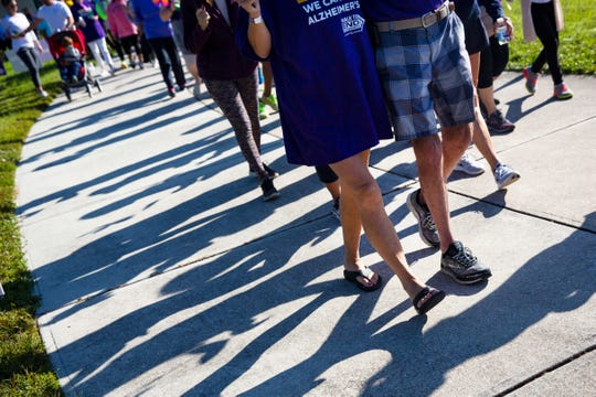 Over 500 people from Collier County and beyond, joined hands for a walk to end Alzheimer's, Saturday morning, Nov. 16, 2018 at North Collier Regional Park. The event focused on raising money for Alzheimer's research and remembering the lives lost due to the degenerative disease.