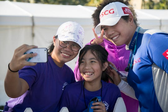 Hazel Paredes, left, and her sister Dylan get a selfie with Ariya Jutanugarn after the third round of the CME Group Tour Championship on Saturday at Tiburón Golf Club in Naples.