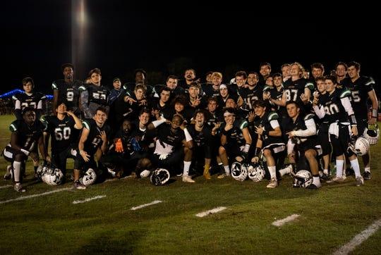 The St. John Neumann High School football team celebrates their 55-14 win over Glades Day School on Friday.