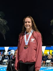 St. John Neumann's Maddy Burt took the bronze medal in the 50 freestyle in the Class 1A state swimming meet on Friday, Nov. 16, 2018 in Stuart.