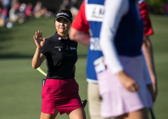 So Yeon Ryu waves to the crowd on the 18th green during the third round of the CME Group Tour Championship on Saturday, Nov.  17, 2018, at Tiburón Golf Club in Naples.