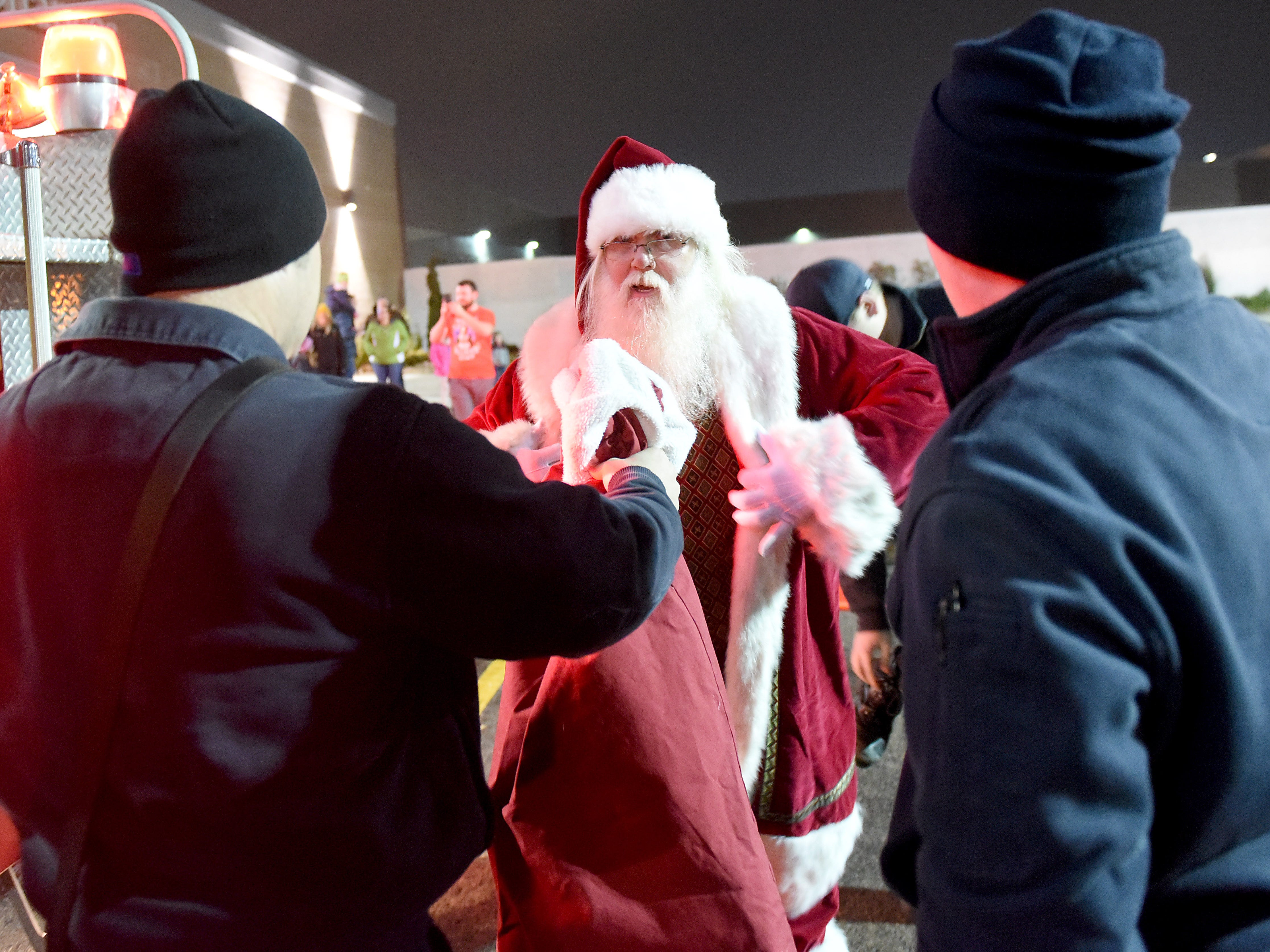 Santa Claus arrived at the Indian Mound Mall on Friday, Nov. 16, 2018. Families enjoyed performances from the Newark High School choir and Newark Catholic cheerleaders, face painting, snacks and the arrival of Santa with help from the Heath Fire Department.