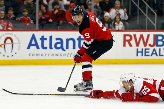 New Jersey Devils left wing Taylor Hall (9) has his pass blocked by Detroit Red Wings defenseman Danny DeKeyser during the second period of an NHL hockey game Saturday, Nov. 17, 2018, in Newark, N.J.