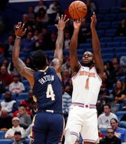 New York Knicks guard Emmanuel Mudiay (1) shoots against New Orleans Pelicans guard Elfrid Payton (4) in the first half of an NBA basketball game in New Orleans, Friday, Nov. 16, 2018.