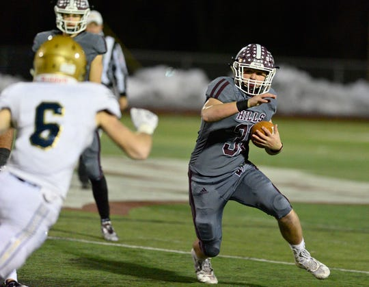 Michael Joyce of Wayne Hills runs the ball in the North 1, Group 4 football championship game against NV/Old Tappan in Wayne on Friday, Nov. 16, 2018. Wayne Hills rallied to win the game 20-13.