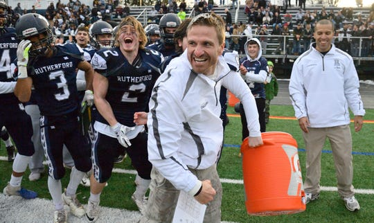 Rutherford coach Andrew Howell celebrates the win in the  North 2, Group 2 football championship game against Lyndhurst in Rutherford.