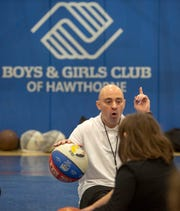 Coach Mike Simmel leads an exercise during a Bounce Out the Stigma project basketball camp on November 17, 2018 at the Hawthorne Boys and Girls Club in Hawthorne, NJ.
