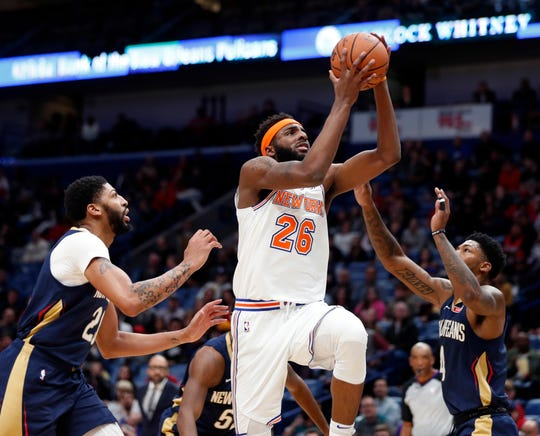 New York Knicks center Mitchell Robinson (26) goes to the basket between New Orleans Pelicans forward Anthony Davis and guard Elfrid Payton (4) in the first half of an NBA basketball game in New Orleans, Friday, Nov. 16, 2018.
