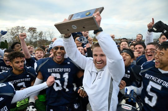 Rutherford coach Andrew Howell celebrates the win with his team in the  North 2, Group 2 football championship game against Lyndhurst in Rutherford.