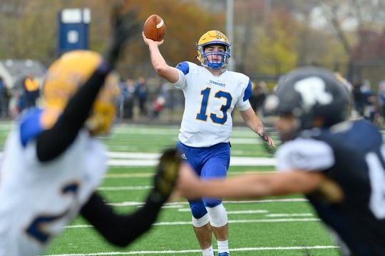 Lyndhurst's Brian Podolski throws a pass in the North 2, Group 2 football championship game against Rutherford in Rutherford.