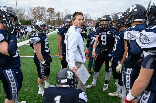 Rutherford coach Andrew Howell speaks to his team in the North 2, Group 2 football championship game against Lyndhurst in Rutherford.