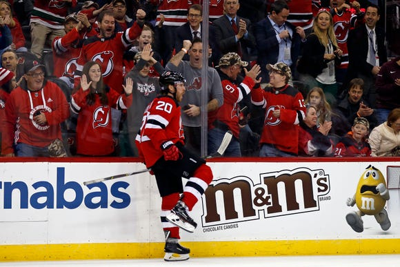 New Jersey Devils center Blake Coleman celebrates scoring a goal against the Detroit Red Wings during the second period of an NHL hockey game Saturday, Nov. 17, 2018, in Newark, N.J.