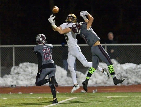 NV/Old Tappan's Jake Piccinich goes up for a catch in the  North 1, Group 4 football championship game against Wayne Hills in Wayne on Friday, Nov. 16, 2018