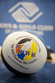"""A """"bounce out the stigma"""" logo on a ball during a Bounce Out the Stigma project basketball camp on November 17, 2018 at the Hawthorne Boys and Girls Club in Hawthorne, NJ."""