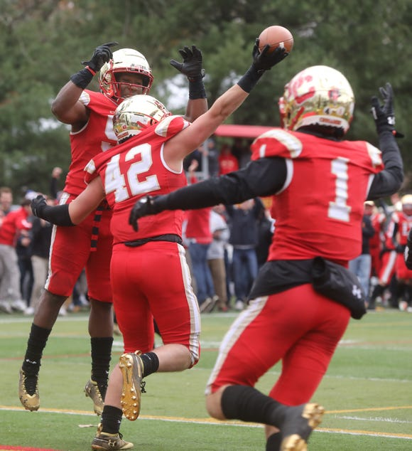 Javon Cruz celebrates a fumble revered for a TD by AJ Longo of Bergen Catholic late in the game. Also celebrating is Pierson Tobia of Bergen Catholic.