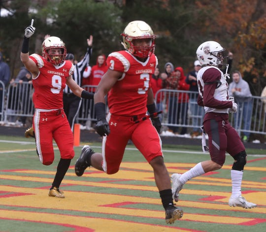 Jack McKee celebrates a TD scored by teammate Anthony Corbin of Bergen Catholic on a fake punt in the second half.