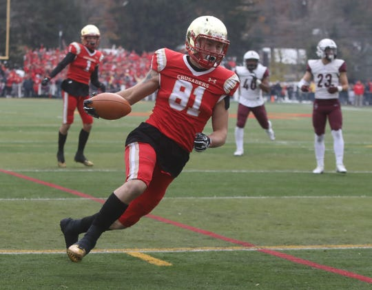 Tyler Devera of Bergen Catholic scores a second half TD.
