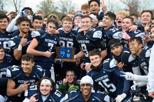 Rutherford players celebrates the win in the North 2, Group 2 football championship game against Lyndhurst in Rutherford.